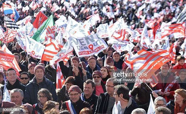 More than 10000 people gather on January 24 in Brest northwestern France during a demonstration to maintain their job at the Credit Mutuel Arkea bank...