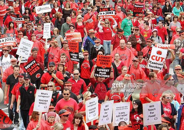 More than 10000 teachers march to Parliament after attending a stopwork meeting in Melbourne in their campaign for a 10 percent pay rise on February...