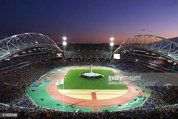 More than 100000 people are gathered at the Olympic Stadium for the closing ceremonies of the Sydney Olympic Gaems 01 October 2000 AFP PHOTO GREG WOOD