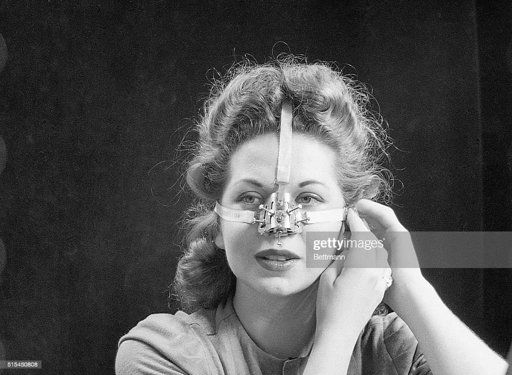 Woman Modeling Nose Shaping Device : News Photo