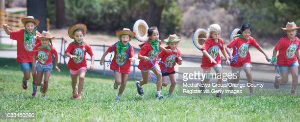 "More than 120 Girl Scouts kick off their week-long ÒHow the West Was FunÓ day camp near Irvine Lakewith a ""scream and run"" game. They also had..."