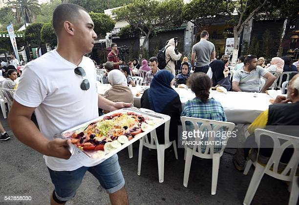 More than 1200 people have broken the Ramadan fast with a giant meal served on Friday evening in Algiers on June 24 2016 Along the Mourad Didouche...