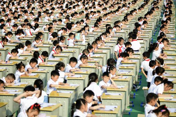 CHN: Students Attend Chinese Calligraphy Competition In Anlong County