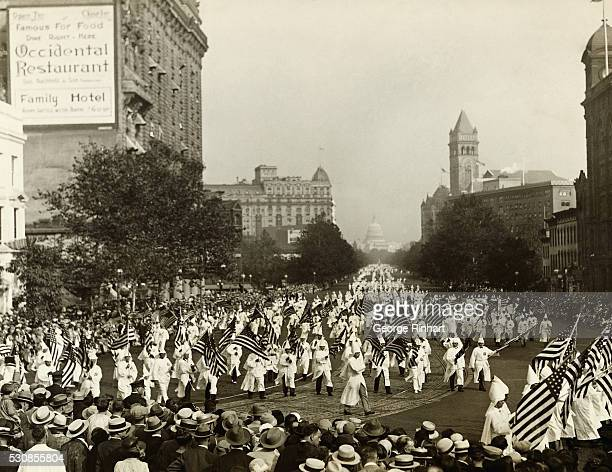 More than 13000 members of the Ku Klux Klan from all sections of the country march in annual parade The participants wore flowing rite robes and...