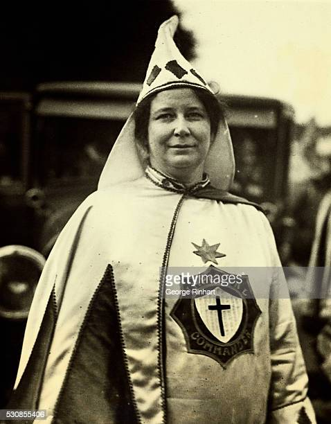 More than 13000 participate in the annual parade of the Ku Klux Klan the costumes of the marchers presenting an attractive picture Photo shows Mrs...