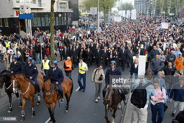 More than 15000 people march in silence to commemorate slain Dutch rightwing politician Pim Fortuyn May 7 2002 in Rotterdam Netherlands Fortuyn was...