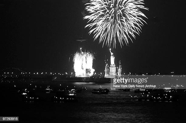 LIBERTY More Than 21Gun Salute Fireworks flare from the base of the Statue of Liberty as sky rockets burst into a shower of pyrotechnics overhead New...