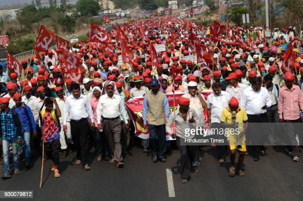 More than 25000 farmers ledby All Indian Kisan Sabha continued their march from Nashik to Mumbai protesting against Maharashtra government's...
