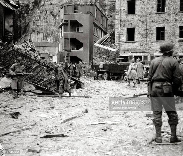 More than 300 German soldiers were captured in the lower sections of the underground Fort du Roule after several attacks by American demolition crews...