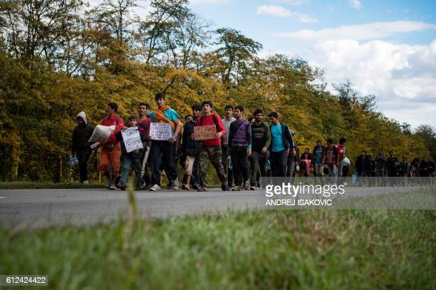More than 300 migrants march from Belgrade towards Hungary near Batajnica neighborhood on October 4 aspiring to enter the European Union two days...