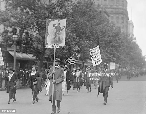 More than 3000 AfricanAmerican protesters marched on the streets of Washington carrying signs urging control and halting of the lynching of blacks...