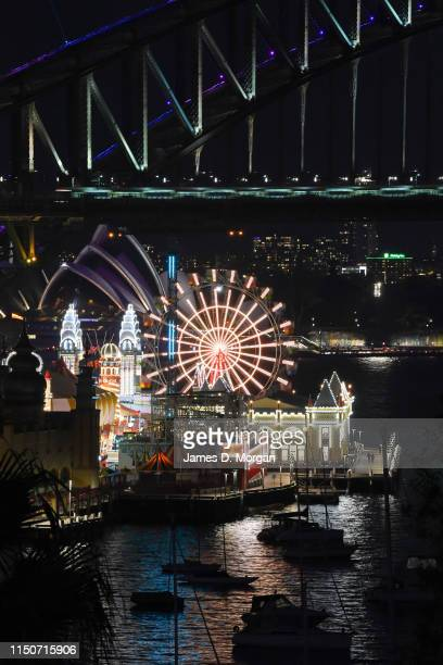 More than 3000 LED lights illuminate the Ferris Wheel with the Harbour Bridge and Opera house in the background during the media preview of Vivid...
