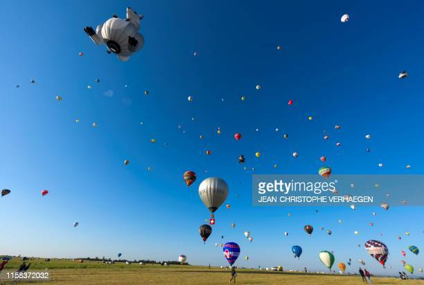 More than 400 hot airballoons take off from the ChambleyBussieres airbase eastern France during a missed attempt to break the simultaneous airballoon...