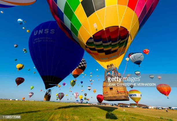 TOPSHOT More than 400 hot airballoons take off from the ChambleyBussieres airbase eastern France during a missed attempt to break the simultaneous...