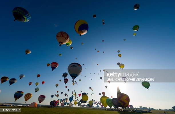 More than 400 hot air-balloons take off from the Chambley-Bussieres airbase, eastern France, during a missed attempt to break the simultaneous...