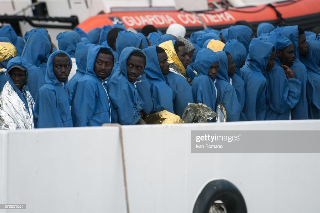More than 400 migrants rescued in the Sicily Channel from the Italian Coast Guard ship the Gregoretti, rest on board the ship on April 19, 2017 in Salerno, Italy.