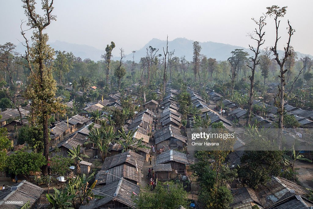 More than 4500 huts are built inside the Beldangi 2 refugee camp where more than 18,000 refugees live on March 13, 2015 in Beldangi, Nepal. More than 22,000 Bhutanese refugees still reside in the refugee camps set up in Nepal in the 1990s, after hundreds of thousands of Bhutanese fled the country following a campaign of ethnic cleansing by the Bhutanese Government against the country's ethnic Nepali population. After more than 20 years in Nepal, over 90% of the refugees have been successfully resettled in third countries, thanks to programs by UNHCR and IOM. Those remaining the camps are supported by several organizations that undertake a wide variety of projects. Helped by remittances sent back to Nepal by families already resettled in other countries, the refugees still in the camps have set up their own small businesses in the camps and the roads near them, roads which are also replete with Nepali-owned businesses who benefit directly from the refugees that are still waiting in Nepal to be resettled in third countries. (Photo by Omar Havana/Getty Images).