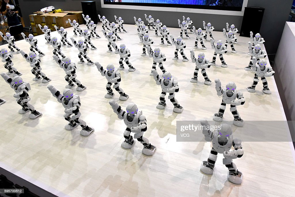 More than 50 robots dance during the opening ceremony of the sixth Shandong Cultural Industries Fair (SDCIF) at Jinan International Convention & Exhibition Center on August 25, 2016 in Jinan, Shandong Province of China.The 50 robots are named 'Alpha' and are connected to cellphones instructing them to perform different actions according to various musical sounds.