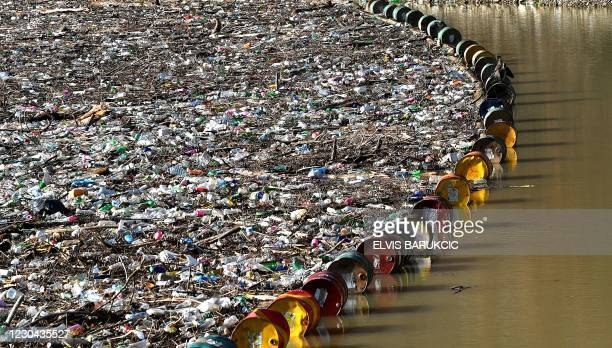 """More than 5,000 cubic meters of waste and debris are seen at the dam of """"Visegrad"""" water power plant, on river Drina, near Eastern-Bosnian town of..."""