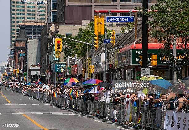 More than 50000 people line Yonge Street in downtown to view the World Pride Parade on June 29 2014 in Toronto Ontario Canada Since its inception in...