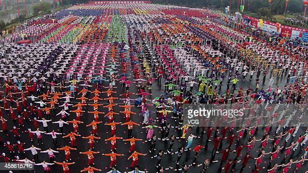 More than 6000 people perform line dance at Baima Lake on November 8 2014 in Hangzhou China 25703 people distributed at 19 different places in...
