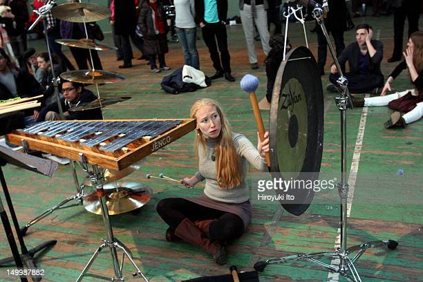 More than 70 percussionists performing John Luther Adams's Inuksuit at Park Avenue Armory as a closing event for the TuneIn Music Festival on Sunday...