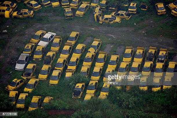 More than 800 scrapped taxis are abandoned in a yard on May 14 2009 in the center of Chongqing China Traffic congestion and pollution have worsened...