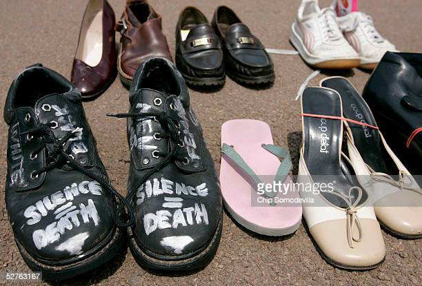 More than 8000 pairs of shoes are laid in the street in front of the White House during the Campaign to End AIDS 'Walk a Mile in My Shoes' march on...