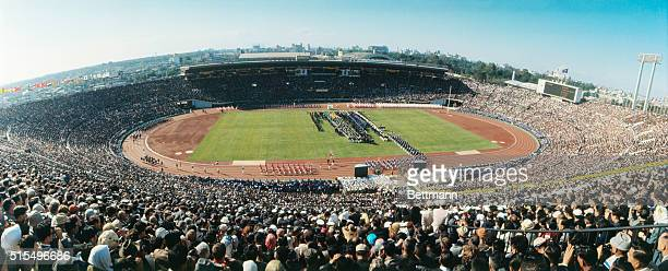 More than 80,000 spectators pack Tokyo's National Stadium for opening ceremonies of the XVIII Olympiad.