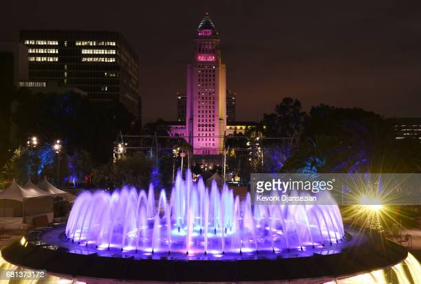 More than a dozen landmark buildings and tourist sites which includes Los Angeles City Hall and the fountain in Grand Park is illuminated in the...