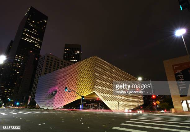 More than a dozen landmark buildings and tourist sites which includes The Broad, a contemporary art museum, illuminated in the colors of Los Angeles...