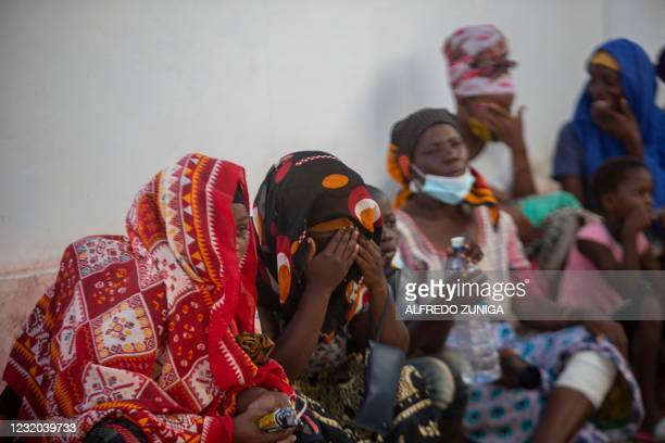 More than a hundred women and men await on the outskirts of the sea port of Pemba the possible arrival of a boat carrying their relatives evacuated...