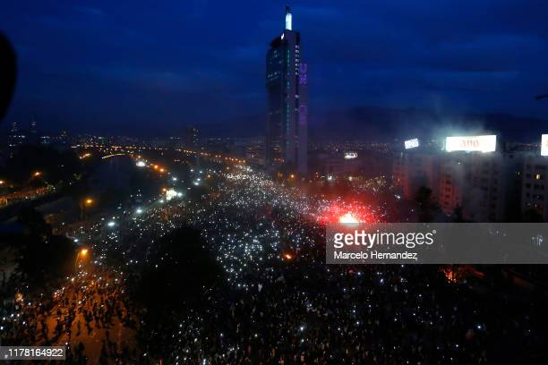 More than a million people gather at Plaza Italia during the eighth day of protests against President Sebastian Piñera's government on October 25...