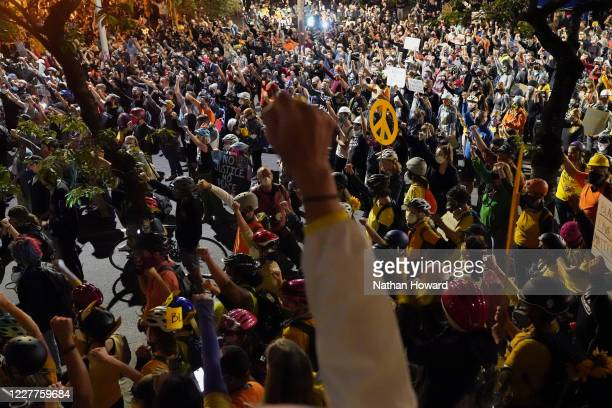 More than a thousand protesters march past Mark O. Hatfield U.S. Courthouse as part of ongoing protests against racial injustice and police brutality...