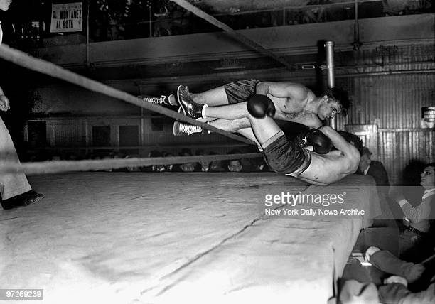 More than fists have been known to fly in the Daily News Golden Gloves These two unidentified glovers showed how on opening night of the 1936 Gloves