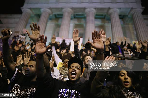 More than one thousand demonstrators chant 'Hands up don't shoot' on the steps of the National Portrait Gallery in protest a day after the Ferguson...