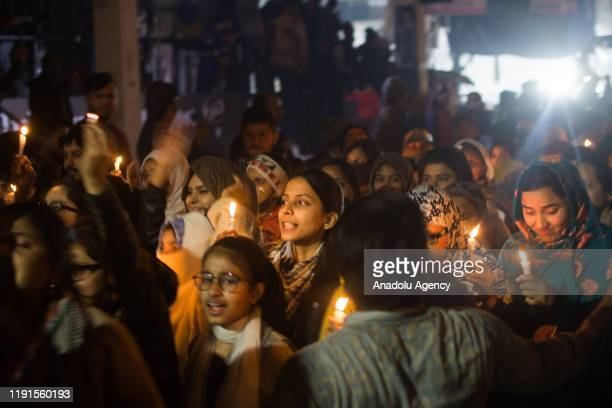 More than thousands people take part in the candle march to support sit-in agitation of women in Shaheen Bagh against Citizenship Amendment Act 2019...