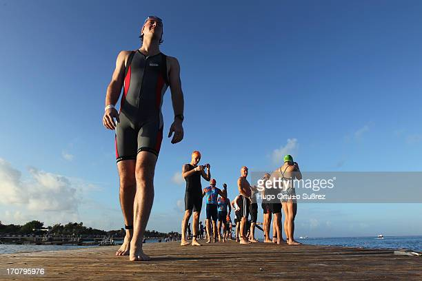 More than two hundred triathletes from 61 countries compete for one of the 50 slots available for the IronMan World Championship to be held in Kona...
