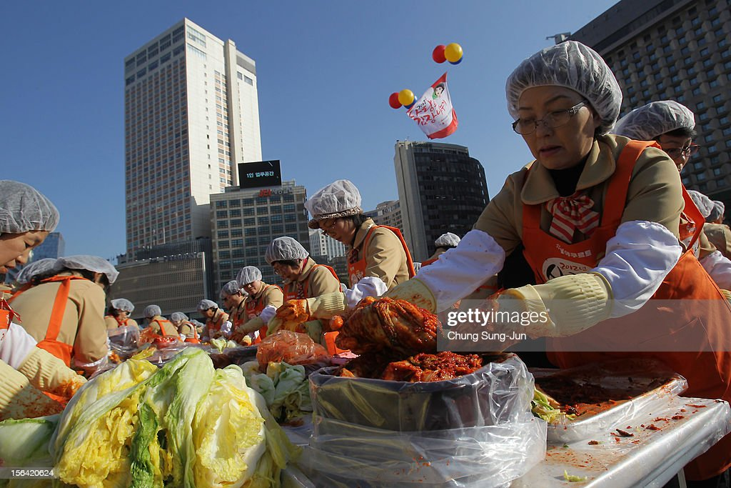 More than two thousands of housewives make Kimchi for donation to the poor in preparation for winter in front of City Hall on November 15, 2012 in Seoul, South Korea. Kimchi is a traditional Korean dish of fermented vegetables usually mixed with chili and eaten with rice or served as a side dish to a main meal.