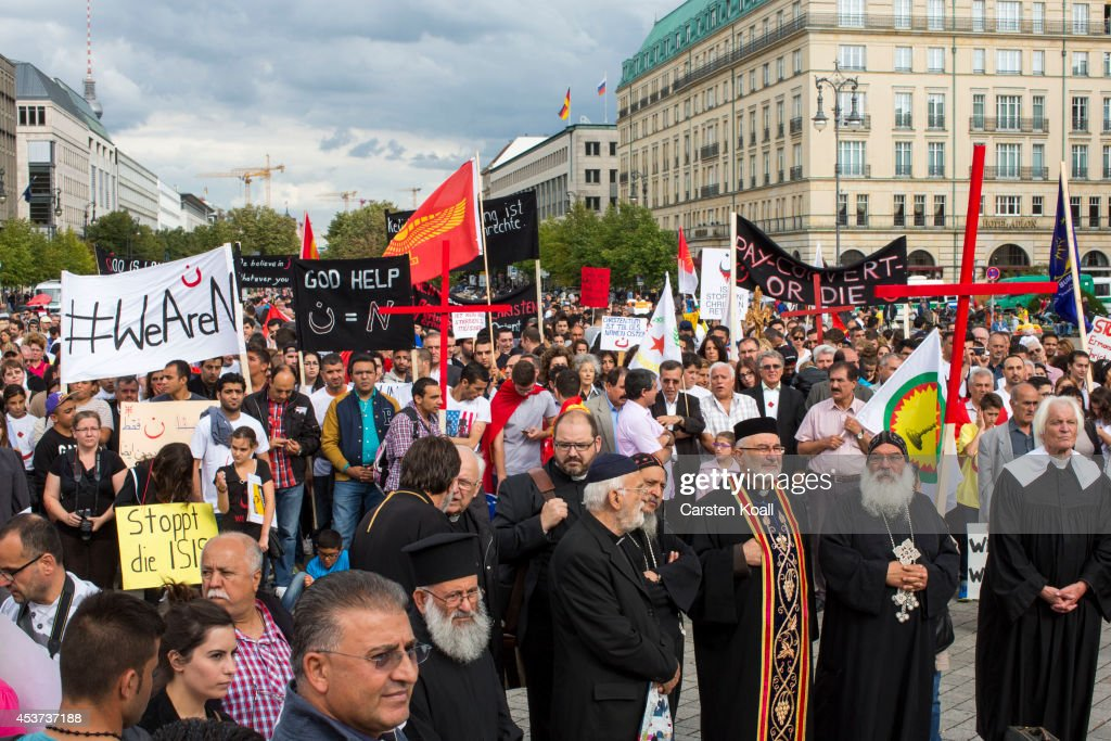 More then thousand participants of several oriental christian groups gather to protest against the ongoing violence against their brethren in Iraq and Syria by ISIS fighters on August 17, 2014 in Berlin, Germany. Tens of thousands of Yazidis, who practice their own religion and are neither Christian nor Muslim have fled targeted violence from ISIS Muslim Sunni fighters in the region of northern Iraq that borders Syria and Kurdish regions. ISIS has targeted Christians and Shia Muslims as well.