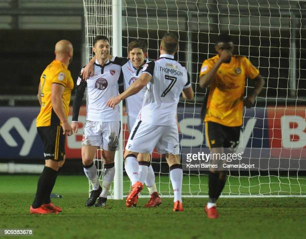 Morecambe's Michael Rose celebrates scoring his side's first goal with teammates Callum Lang and Garry Thompson during the Sky Bet League Two match...