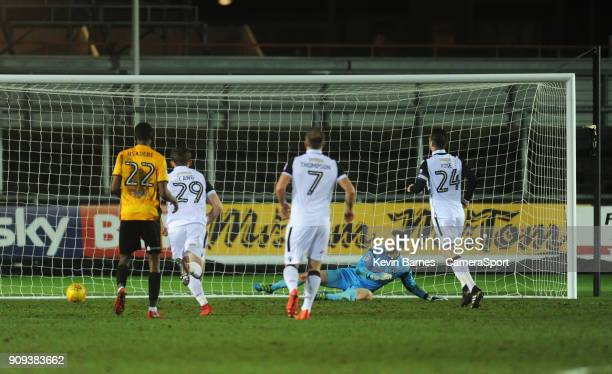 Morecambe's Michael Rose scores his side's first goal during the Sky Bet League Two match between Newport County and Morecambe at Rodney Parade on...