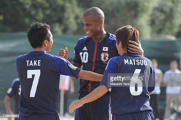 Moreira Oz of Japan celebrates the goal of Takeshi Kawaharazuka during the beach soccer international friendly between Japan and Switzerland at...