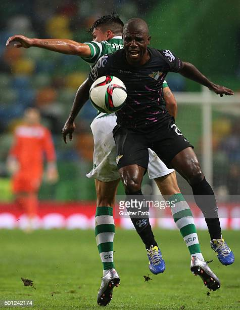 Moreirense FC's midfielder Vitor Gomes with Sporting CP's defender Jonathan Silva in action during the Primeira Liga match between Sporting CP and...