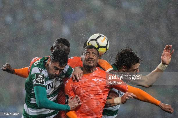 Moreirense's defender Iago Santos heads the ball in the middle of Sporting's defender Andre Pinto and Sporting's defender Sebastian Coates during the...