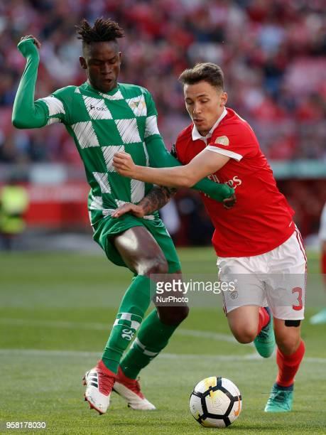 Moreirense's midfielder Alfa Semedo vies for the ball with Benfica's defender Alejandro Grimaldo during the Portuguese League football match between...