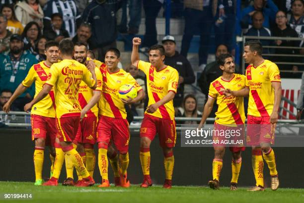 Morelia« players celebrate after scoring against Monterrey during the Mexican Clausura 2018 tournament final football match at the BBVA Bancomer...