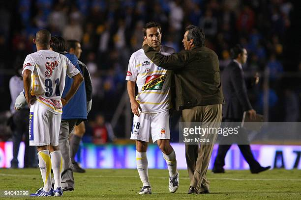 Morelia's Head Coach Tomas Boy and Luis Gabriel Rey react after losing to Cruz Azul on their semifinals match as part of the 2009 Opening tournament...