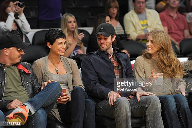 Morena Baccarin Darren Le Gallo and Amy Adams attend a game between the Utah Jazz and the Los Angeles Lakers at Staples Center on April 5 2011 in Los...