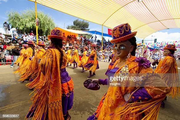Morenada Dancers Wearing Masks In The Procession Of The Carnaval De Oruro, Oruro, Bolivia
